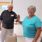 New CLA president Connie Anderson accepting the keys to the lake from past president Glen Peterson